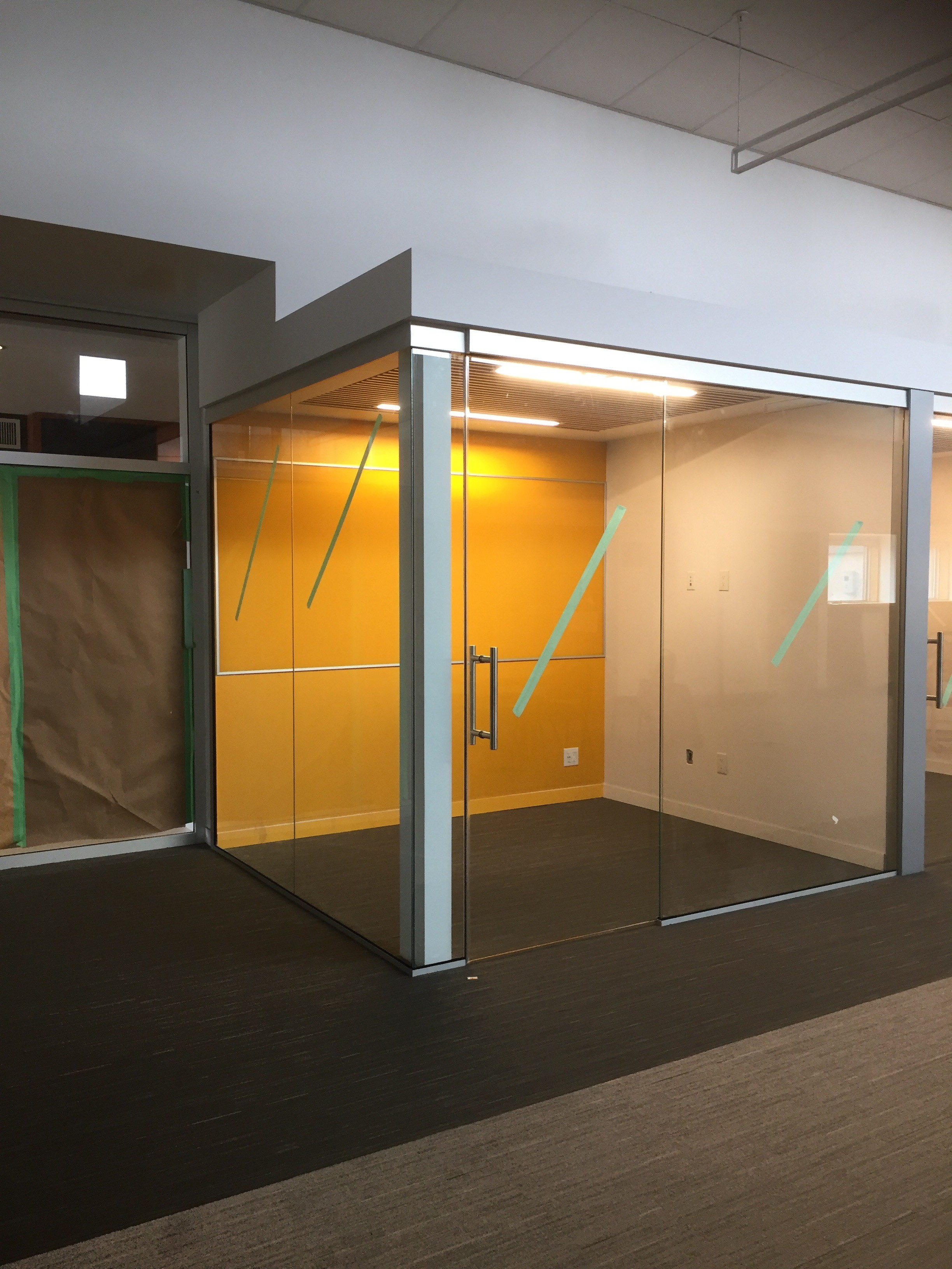 interior office glass walls sliding glass doors curtain