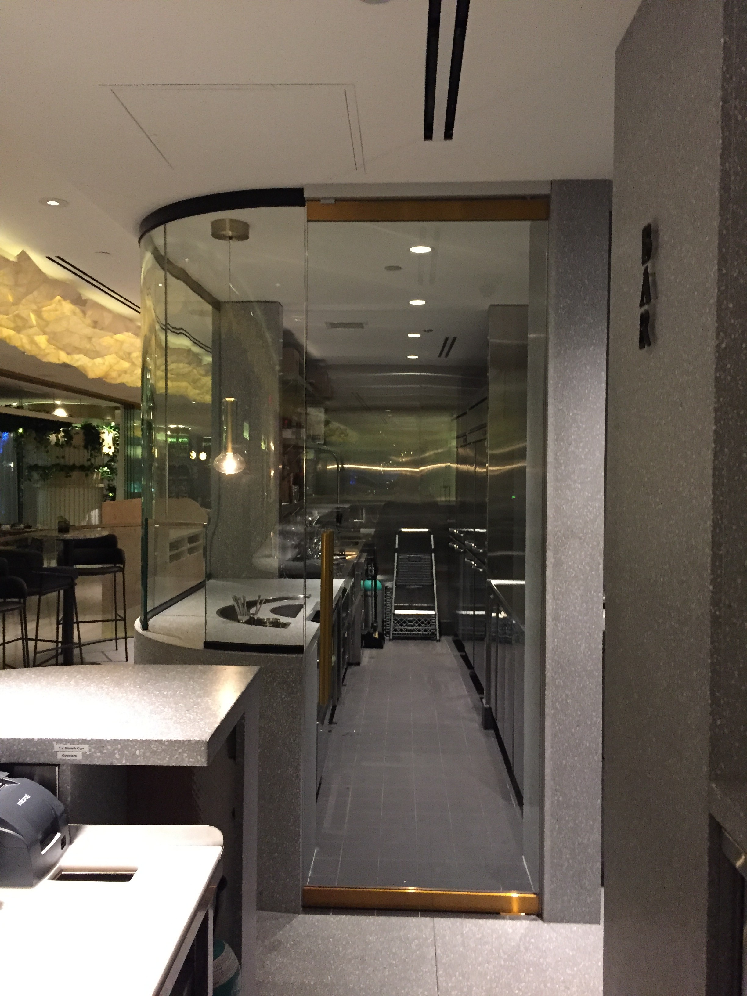 Botanist 5 star restaurant at fairmont pacific rim hotel for Curved glass wall