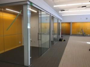sliding glass doors, glass walls, colored writing glass board
