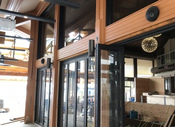 Commercial Aluminum Glass Folding Doors creating three large opening at this storefront